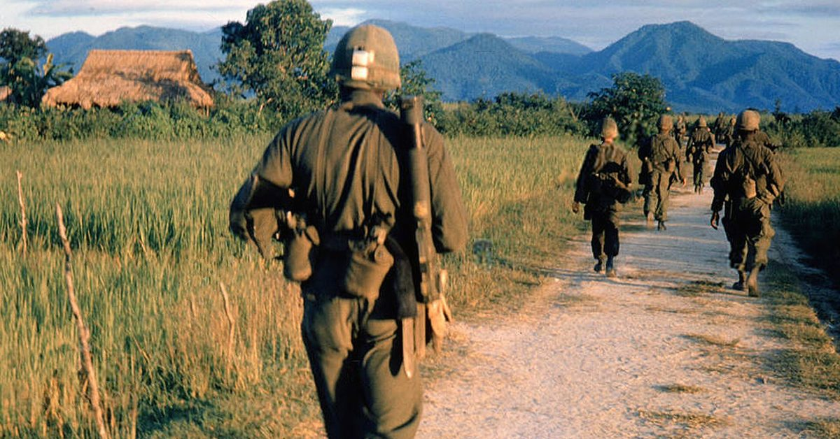 Vietnam War 1957 - 1975 American soldiers on a patrol South Vietnam 1965 equipment equipments road roads dirt path dirt track